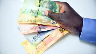 A handful of  rand notes.  Picture: Karen Sandison/ANA