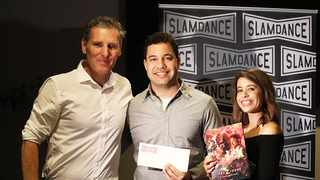 Peter Baxter, president and co-founder of Slamdance, with the runner-up in the Horror category, Raoul Dyssell, and his sister Roxsanne.