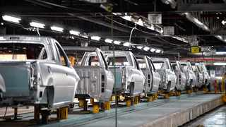 File Image: A line of NP 200 vehicles at the Nissan plant waiting to be fitted.