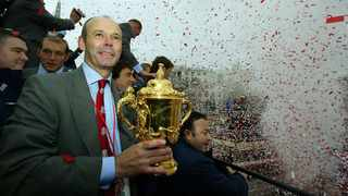 England coach Clive Woodward, holding the William Webb Ellis trophy, accompanies the 2003 Rugby World Cup squad as they arrive in Trafalgar Square at the end of their parade through the capital to mark the team's victory, in London. Photo: REUTERS/David Rogers
