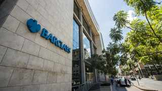A logo sits on display outside the offices of Barclays Plc bank in Johannesburg. Photographer: Waldo Swiegers/Bloomberg