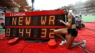 Kenya's Beatrice Chepkoech in front of the stadium clock showing her new steeplechase world record. Photo: Eric Gaillard/Reuters