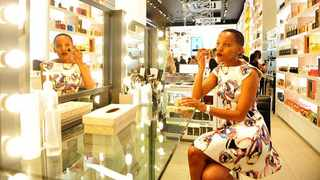 Mathahle Stofile applying make-up at the Skins Cosmetic. Picture; Itumeleng English.