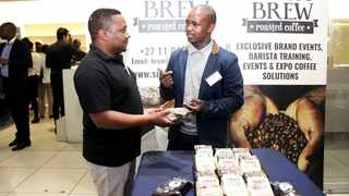 MAKING MOVES: Sihle Magubane talks to a potential customer about his coffee brand, Sihle's Brew. Picture: Dimpho Maja/ANA