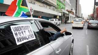 Uber and Taxify drivers hooted and waved flags on Loop Street to raise awareness of poor working conditions. Picture: Armand Hough / African News Agency (ANA).