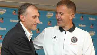 Kaizer Chiefs coach Giovanni Solinas and Orlando Pirates mentor Milutin Sredojevic catch up during a PSL press conference on Thursday. Photo: Aubrey Kgakatsi/BackpagePix