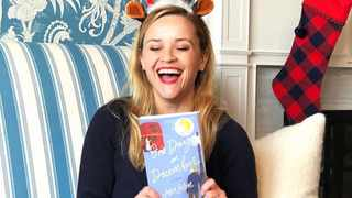 Reese Witherspoon with her December book pick, One Day In December by Josie Silver. Picture: Instagram.