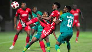 Sphiwe Mahlangu of Highlands Park gets boot to the ball before Siyethemba Sithebe and Ovidy Karuru of AmaZulu FC at King Zwelithini Stadium. Photo: Gerhard Duraan/BackpagePix