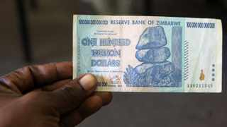 Zimbabwe will introduce a new currency in the next 12 months, the finance minister said, as a shortage of US dollars plunged the financial system into disarray. Picture: Reuters/Philimon Bulawayo