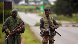 Soldiers patrol during protests on a road leading to Harare, Zimbabwe, during protests. Picture: Reuters/Philimon Bulawayo