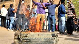 Sudanese demonstrators burn a tyre as they participate in anti-government protests in Khartoum. Picture: Reuters/Mohamed Nureldin Abdallah