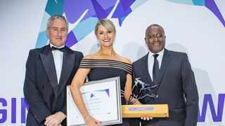 RECM's managing director, Linda Eedes, accepts the Raging Bull Award from Personal Finance content editor Martin Hesse and Butana Khosa, the executive director of Vunani Limited.