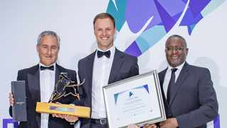 Philip Bradford, manager of the Sasfin BCI Flexible Income Fund (centre), accepts the Raging Bull Award from Personal Finance content editor Martin Hesse and Butana Khosa, the executive director of Vunani Limited.