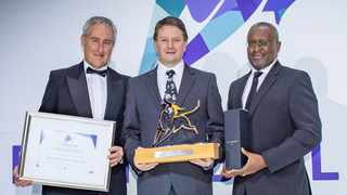 The co-manager of the BlueAlpha BCI Global Equity Fund, Walter Jacobs (centre), accepts the Raging Bull Award from Personal Finance content editor Martin Hesse and Butana Khosa, the executive director of Vunani Limited.