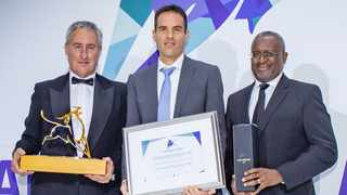 Kevin Posen from Contrarius (centre) accepts the Raging Bull Award from Personal Finance content editor Martin Hesse and Butana Khosa, the executive director of Vunani Limited.