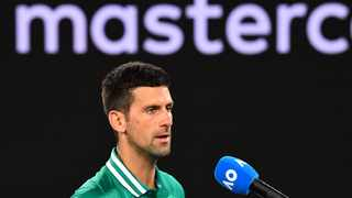 Serbia's Novak Djokovic speaks after winning against Taylor Fritz of the US during their men's singles match on day five of the Australian Open tennis tournament in Melbourne on Friday. Photo: William West/AFP