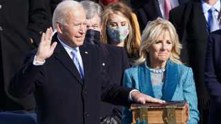 Joe Biden is sworn in as the 46th President of the United States as his wife Jill Biden holds a bible on the West Front of the US Capitol in Washington. Picture: Kevin Lamarque/Reuters