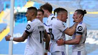 Leeds United's Jack Harrison celebrates with teammates after scoring their first goal during their Premier League clash against Sheffield United. Photo: Lindsey Parnaby/Reuters