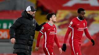 Liverpool manager Jurgen Klopp, Liverpool's Andrew Robertson and Divock Origi react after the match. Laurence Griffiths/Reuters
