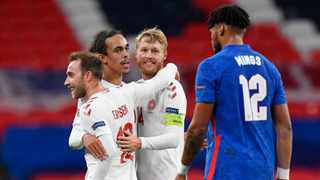 Denmark's Christian Eriksen celebrates with Simon Kjaer and Yussuf Poulsen after their win against England. Photo: Toby Melville/Reuters