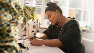Carin Rhoode, 50, formerly homeless, now proudly calls herself a jewellery designer, creating intricate pieces to be sold, as well as masks and artwork. Picture: Supplied