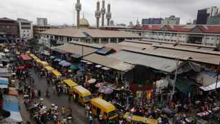 Pedestrians shop at a market in Lagos, Nigeria. Corruption is damaging the economy of African states. Nigeria and South Africa are key protagonists on the continent. Picture: AP