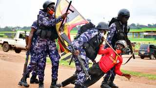 File photo: Ugandan riot policemen detain a supporter of presidential candidate Robert Kyagulanyi, also known as Bobi Wine, in Luuka district. Picture: Reuters