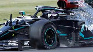 Mercedes' Lewis Hamilton drives with a punctured tyre during the final lap of the British Grand Prix at Silverstone on Sunday. Photo: Andrew Boyers/Reuters
