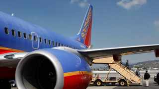 File photo: The airline also says it issues a full refund when an individual is removed from a flight for being unable to wear a mask. Picture: AP