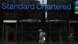 Standard Chartered said on Thursday it would merge several of its businesses including retail, private and business banking divisions and reduce the number of top executives as the Asia and Africa-focused bank seeks to trim costs and create a leaner business. Photo: File