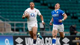 England's wing Anthony Watson (L) runs to score his team's fourth try, his second, during the Six Nations game against Italy. Photo: Adrian Dennis/AFP