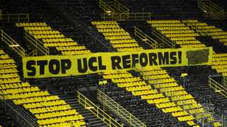 "FILE - In this file photo taken on March 09, 2021 a banner is on display which reads ""Stop UCL reforms"". Phoyo: Ina Fassbender/AFP"