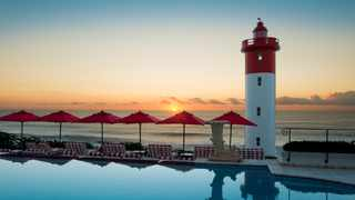 The lighthouse at uMhlanga Rocks stands like a sentinel at the edge of the Oyster Box pool.