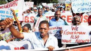 The South Durban Communities Environmental Allaince ( SDCEA) and other NGO's and community organisations took to the central streets of Durban on Saturday to protest the Port Expansion Project in favour of neo liberal economic policies that will benefit these communities but rather governments and corporations invested in this project.A multitude of issues proposed development, such as increased trucking on residential roads and national roads, and the inevitability of increased truck-related deaths;conversion of the Clairwood Racecourse, the 'green lung' of south Durban, into a logistics park and container depot;denial of fisherfolk access to the beachfront and various piers, and ultimately their livelihood;displacement of farmers and farmworkers currently occupying land next to the former Durban airport; and increased health related impacts due to the expansion of the petro-chemical industrial hub and the contribution of the entire project to climate change.PHOTO:RAJESH JANTILAL