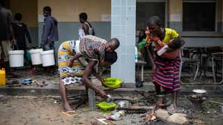 A family from Nharrime takes shelter in the Samora Machel school to take shelter from Tropical Cyclone Eloise in Beira, Mozambique. Picture: UNICEF/Franco/Handout via Reuters