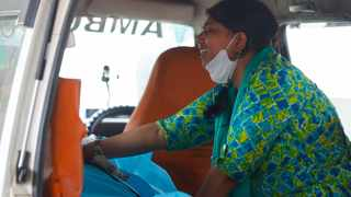 Aanchal Sharma cries over the body of her husband, who died from the coronavirus disease (Covid-19), inside an ambulance at a crematorium ground in New Delhi, India. Picture: Adnan Abidi/Reuters