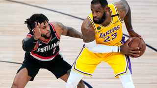 Anthony Davis scored 43 points and LeBron James added 36 to lead the Los Angeles Lakers to a 131-122 victory over the Portland Trail Blazers on Saturday night near Orlando to win the Western Conference first-round series in five games. Picture: Ashley Landis/AP