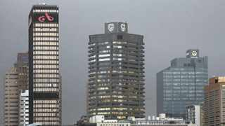 The logos of three of South Africa's biggest banks - Absa, Standard Bank and First National Bank - adorn buildings in Cape Town. Picture: Mike Hutchings