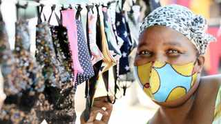 Patricia Mdingi sells a variety of masks from basic to bling at the Workshop market in Durban. We are not in the clear just yet, so keep wearing your mask and practice social distancing.