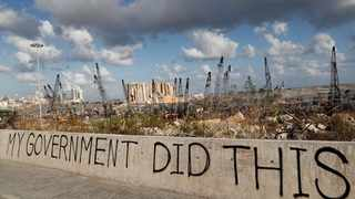 Words written by Lebanese citizens in front the scene of Tuesday's explosion. AP Photo/Hussein Malla.