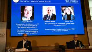 David Haviland of the Nobel Committee for Physics and Secretary General of the Royal Swedish Academy of Sciences Goran K. Hansson announce the winners of the 2020 Nobel Prize in Physics in Stockholm. Picture: TT News Agency/Fredrik Sandberg via Reuters