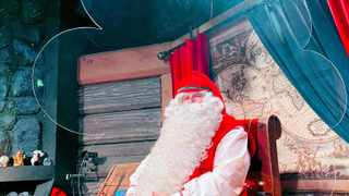 Santa Claus is pictured in his chamber behind a plexiglas screen at Santa Claus Village in the Arctic Circle near Rovaniemi, Finland. Picture: Reuters/Attila Cser