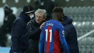 FILE - Crystal Palace manager Roy Hodgson with Wilfried Zaha as he walks off after sustaining an injury. Photo: Lee Smith/Reuters