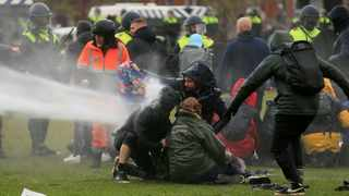 Police uses a water canon during a protest against restrictions put in place to curb the spread of the coronavirus disease (Covid-19), in Amsterdam, Netherlands. Picture: Eva Plevier/Reuters
