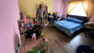 Linda Mbatha in his former bedroom that is now home to 10 vulnerable girls. Picture: KEIVN RITCHIE