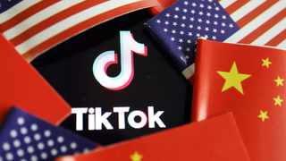 China and US flags are seen near a TikTok logo. Photo: Reuters