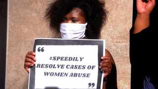 A woman holds a poster with a message in the fight against gender-based violence. Picture: Ayanda Ndamane African News Agency/ANA