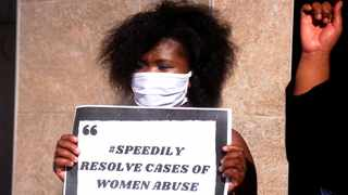 A woman holds a placard at a protest against gender-based violence. Picture: Ayanda Ndamane/African News Agency(ANA)