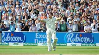 England's Rory Burns celebrates after scoring a century during the second day of the first Ashes Test. Photo: Rui Vieira/Reuters
