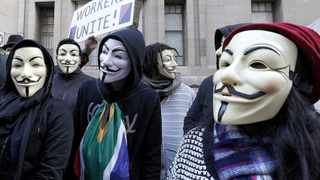 Cape Town-140705. Masked hacktivist group Anonymous Cape Town walked through central Cape Town yesterday (Saturday), informing locals about their work and threatening to bring down businesses and government departments that do citizens any wrong. .reporter: Yazeed Kamaldien. Photo: Jason Boud